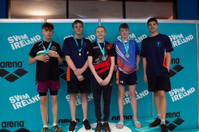 ADAM WILSON – 400IM GOLD & IRISH CHAMPION (centre) pictured with medal winners including Toronto swimmers receiving comematrive medals