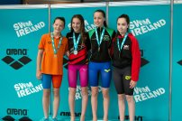 Jodie McMullen – SILVER MEDAL (2nd left) and celebrating achieving Ulster Regional Squad time at the recent Irish Championships